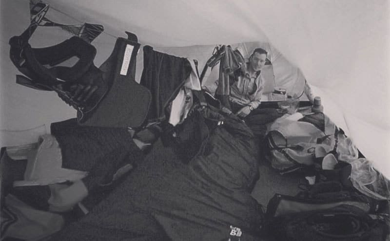 Colin O'Brady in his tent with his gear hung up