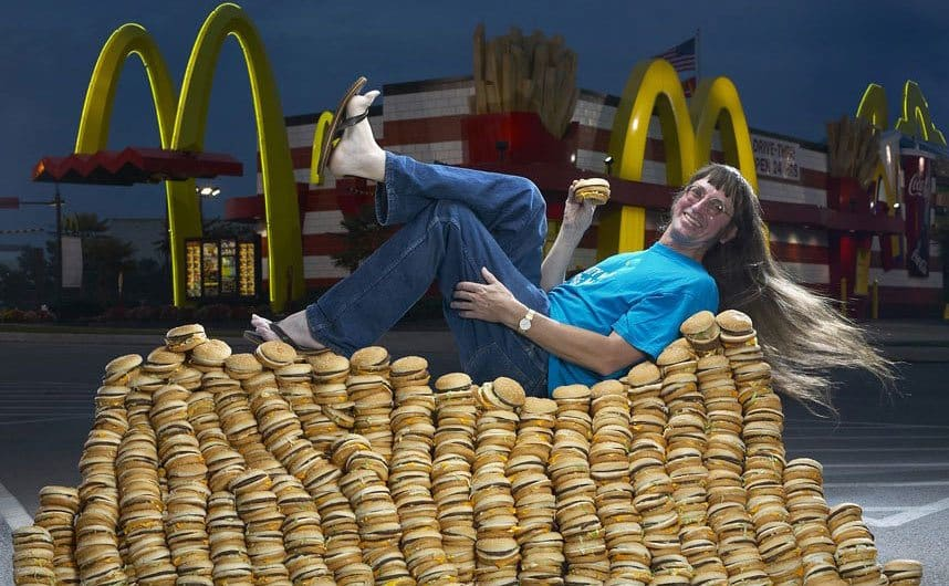 Don Goreske sitting on top of a pile of Big Macs like it's his throne.