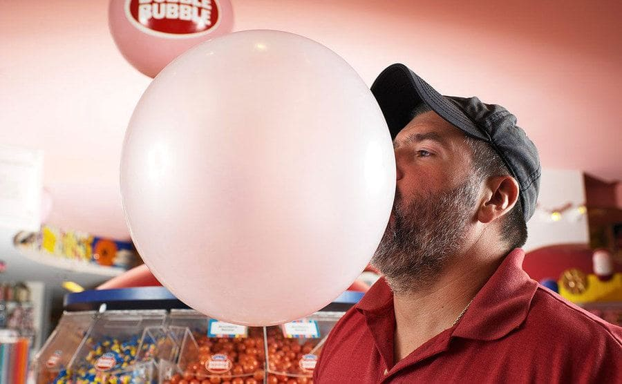 Chad Fell blowing a bubble with bubble gum larger than your head.