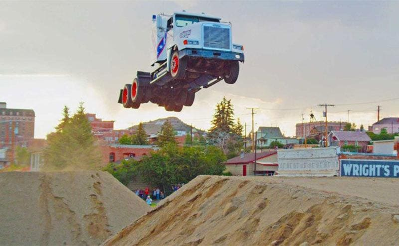 A truck cab flying through the air over the jump that Gregg Godfrey completed.