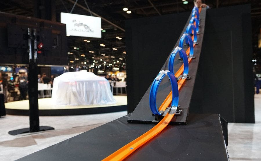 A seven loop hot wheels track coming down in an angel to increase momentum.