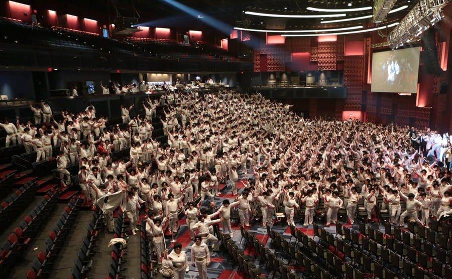An auditorium filled with Elvis impersonators.