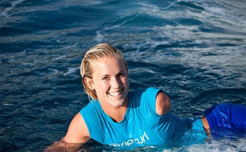 Bethany, after the shark attack back on her board and in the water, looking as happy as ever.