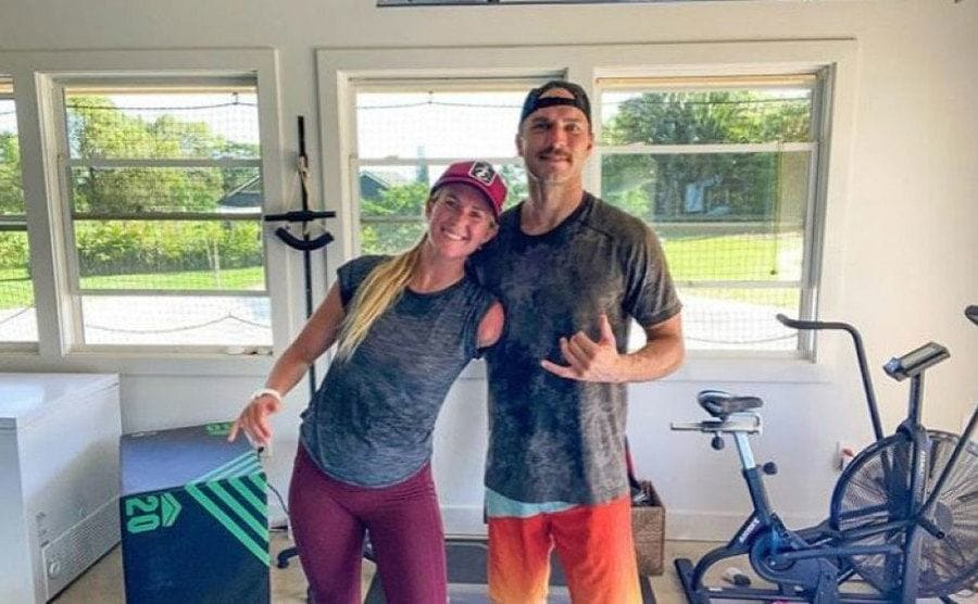 Bethany and her husband Adam taking a post-workout photo at home.