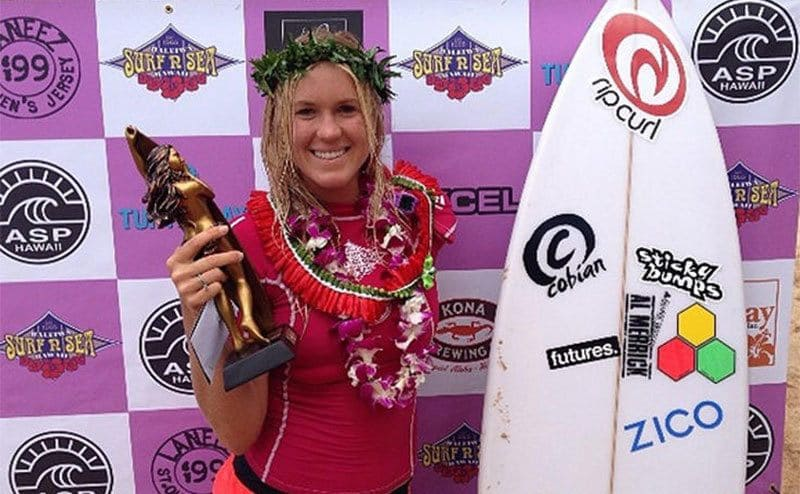 Bethany is holding her first-place prize at the Pipeline Women's Pro.