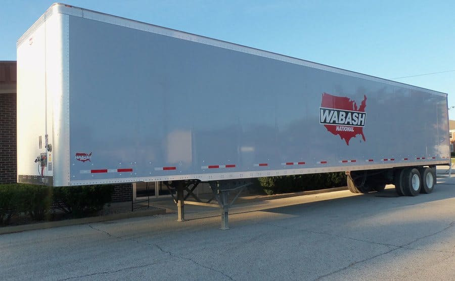 A parked Wabash truck trailer with no cab attached to it.