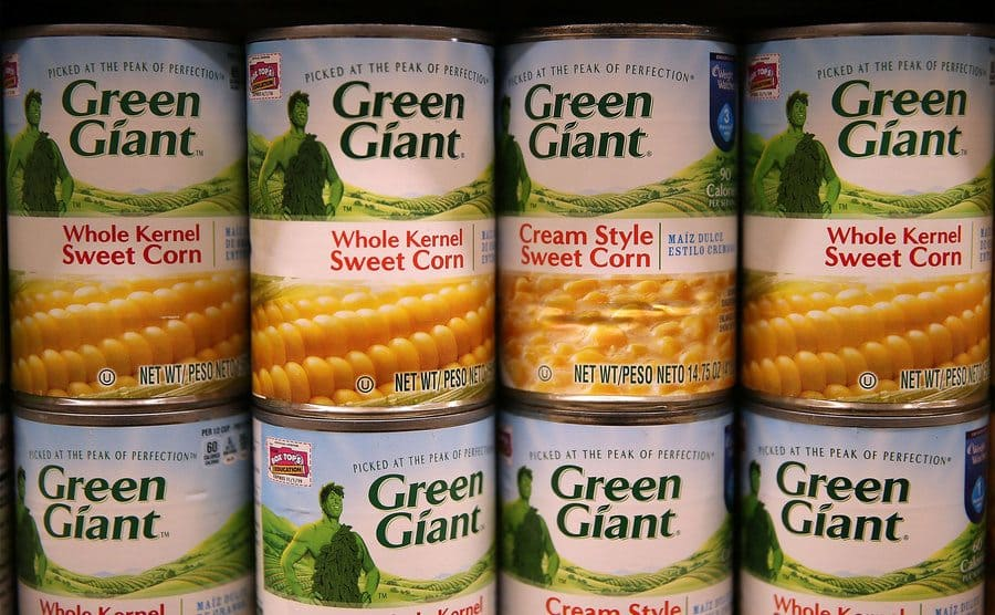 Cans of General Mills Green Giant corn are displayed at a supermarket