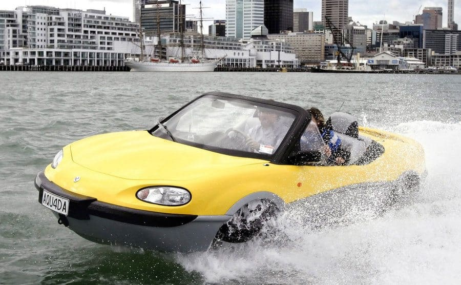 A yellow car which is also a boat