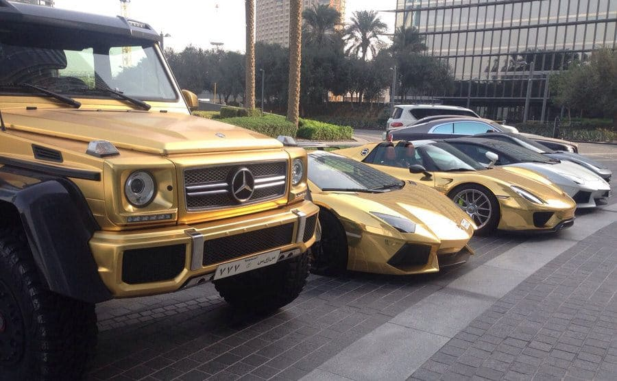 Gold cars lined up in a parking lot