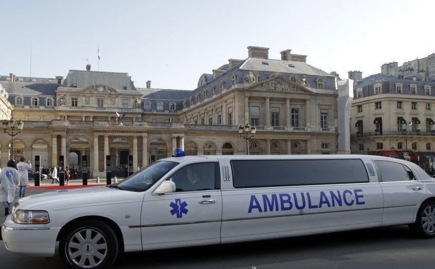 A limo with ambulance written on it