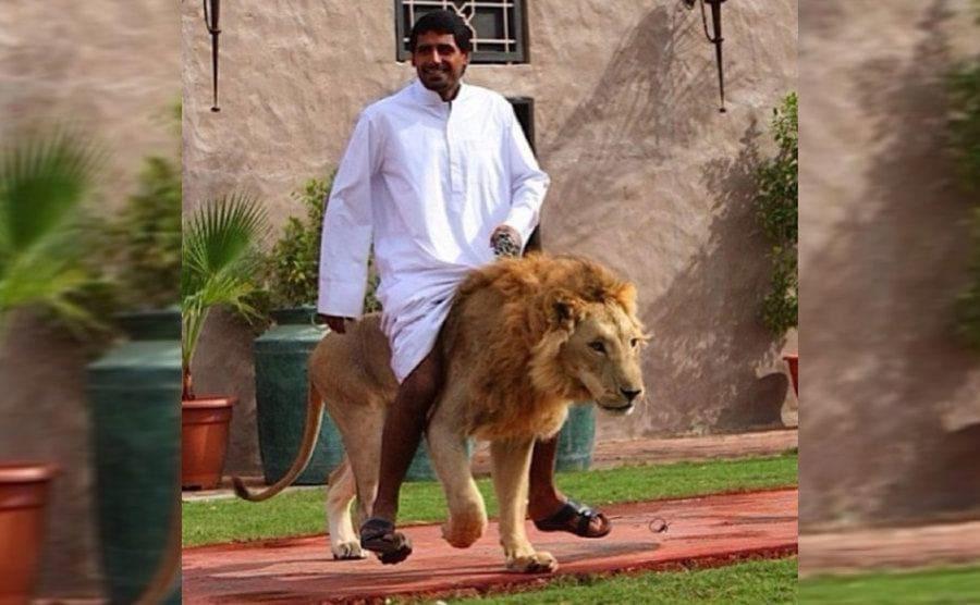 A man riding on a lion