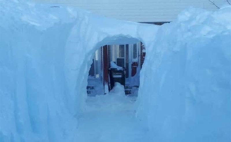 A tunnel of snow that leads to the front door.