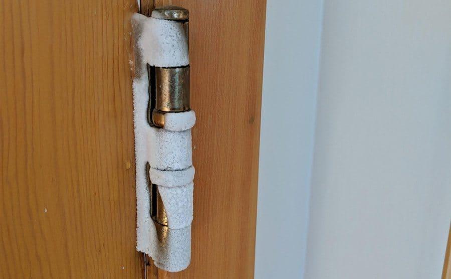 A bit of frost creeping onto the door hinges.