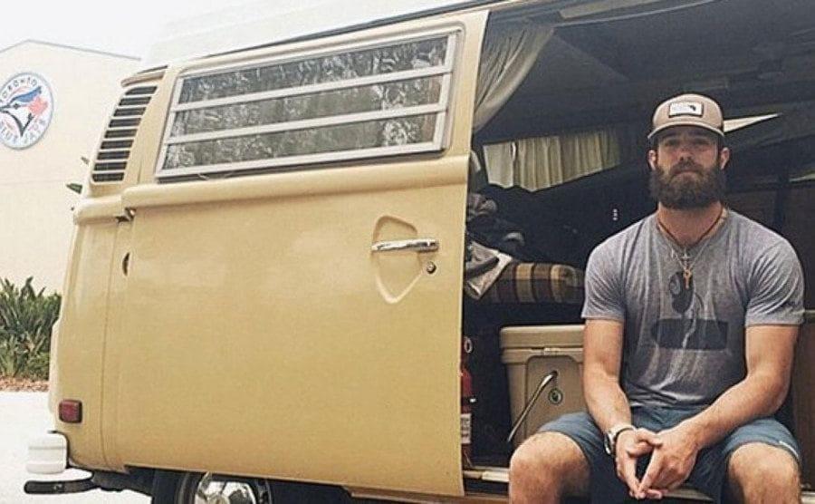 Daniel sitiing in his van.