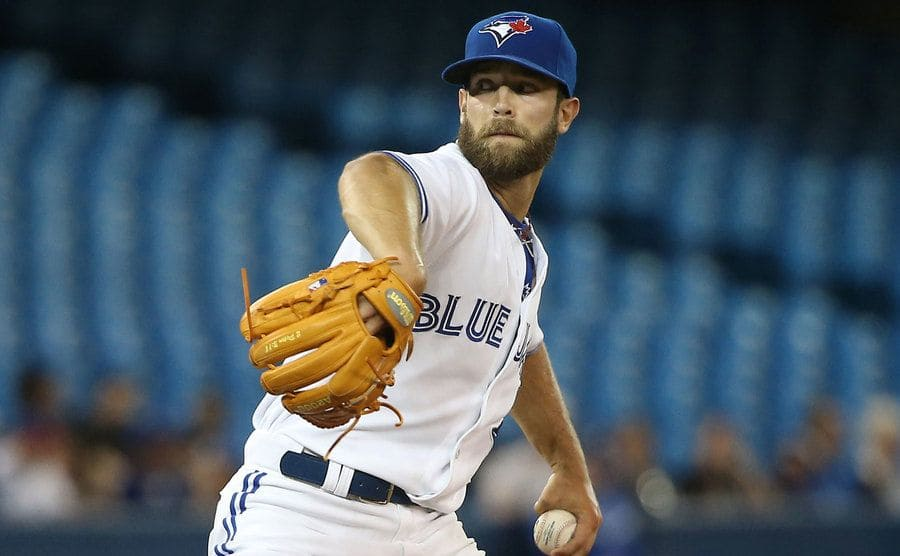 Daniel Norris #32 of the Toronto Blue Jays delivers a pitch in the third inning during MLB game