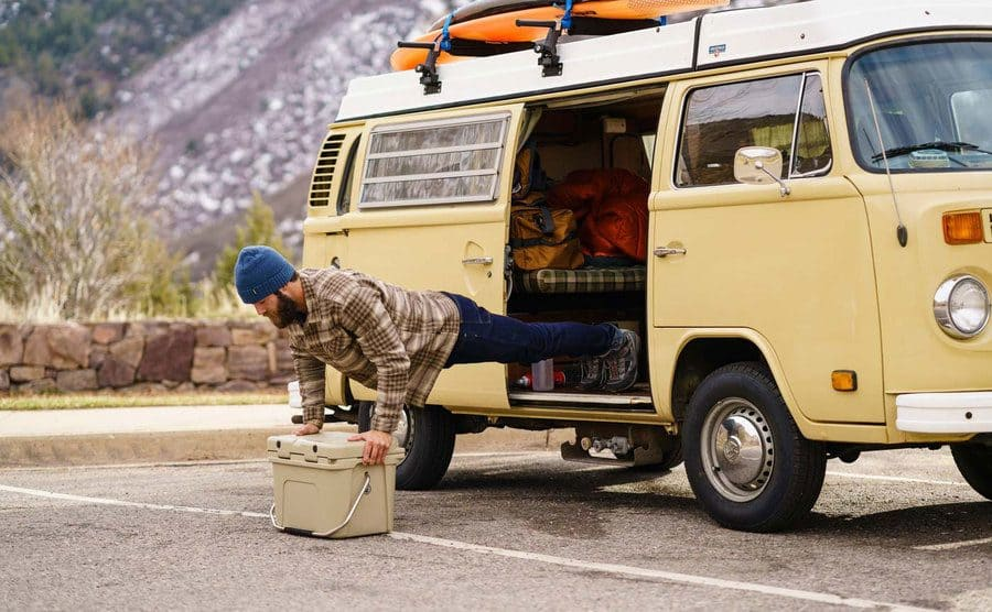Daniel Norris doing pushups out the side of his van on a YETI cooler.