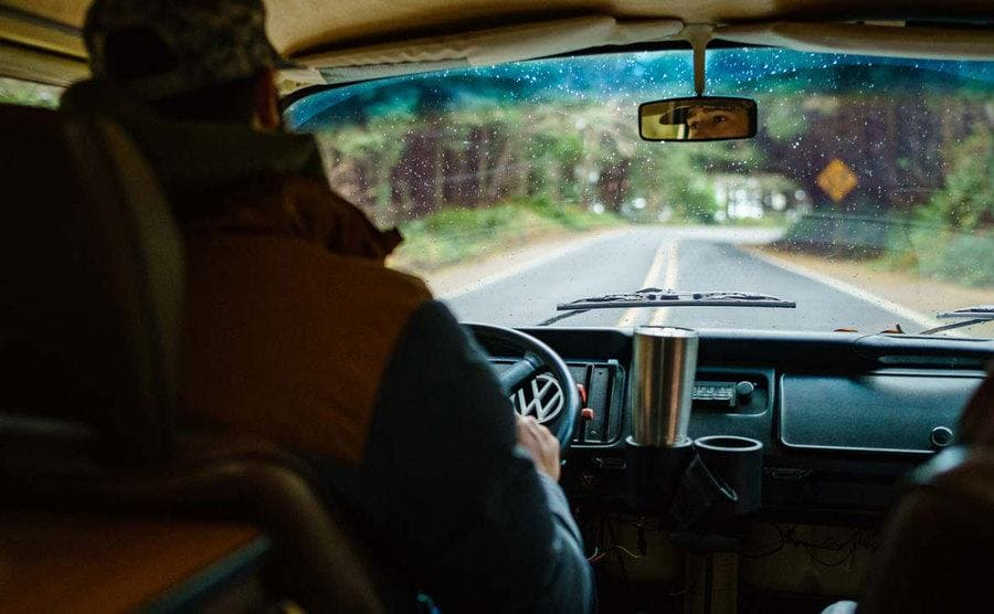 A photo of Daniel Norris driving his van looking out the front windshield.