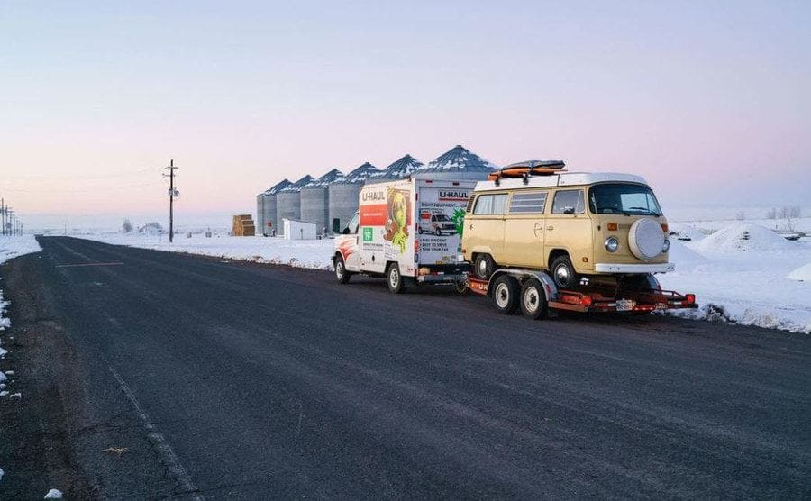 Shaggy, the van, being pulled by a U-haul through the snowy roads.