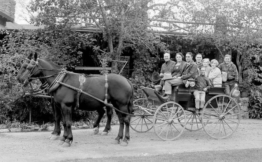 A family in a horse-drawn wagon is ready for a ride through Golden Gate Park in San Francisco, California.