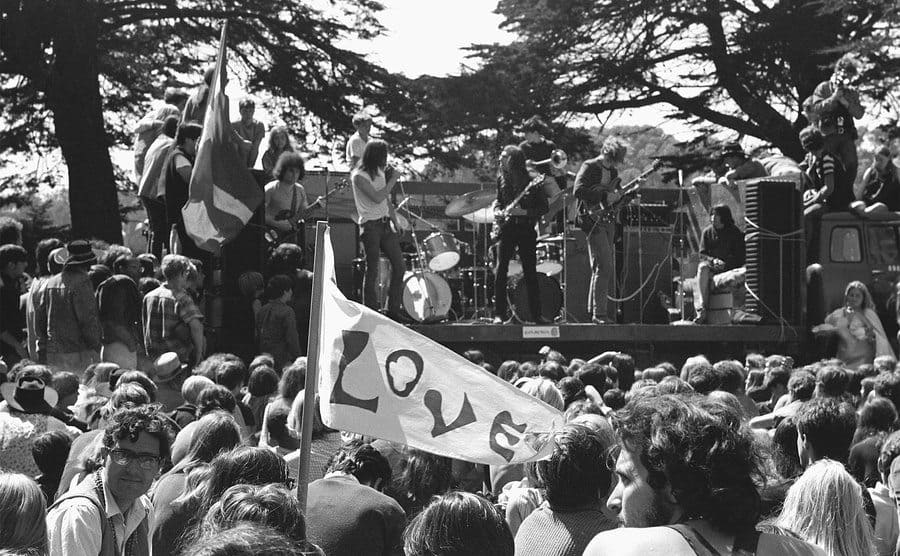A crowd of hippies listens to a band play at a summer solstice celebration at Golden Gate Park in San Francisco.