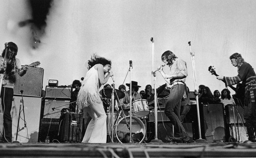 Singer Grace Slick performs with the American rock group Jefferson Airplane at the Woodstock music festival.