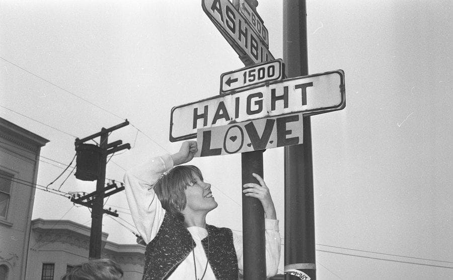 The street sign is changed at the corner of Haight and Ashbury to include LOVE, March 1, 1967.