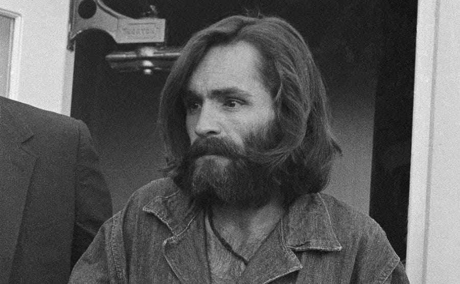 Charles Manson, 34, arrives at the Inyo County Courthouse December 3rd for a preliminary hearing on charges of arson and receiving stolen goods.
