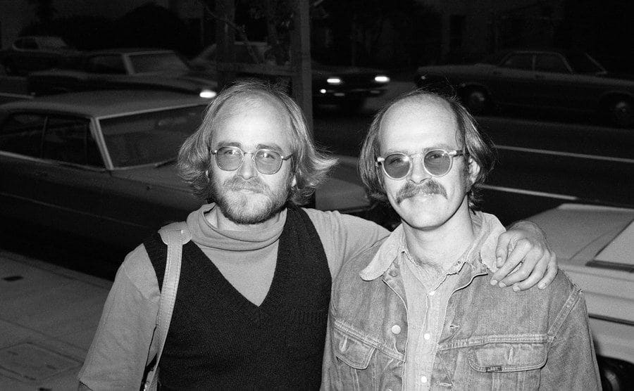 Portrait of American sibling businessmen James 'Jim' Mitchell and Artie Mitchell as they arrive at an unspecified party, San Francisco.