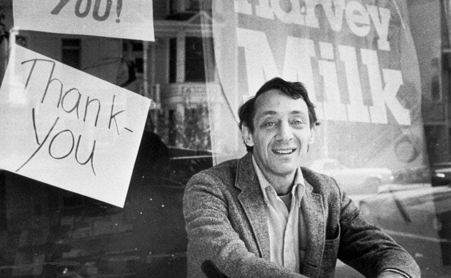 Harvey Milk (1930 - 1978), an openly gay member of the San Francisco Board of Supervisors, sits outside his camera shop in San Francisco, November 9, 1977.