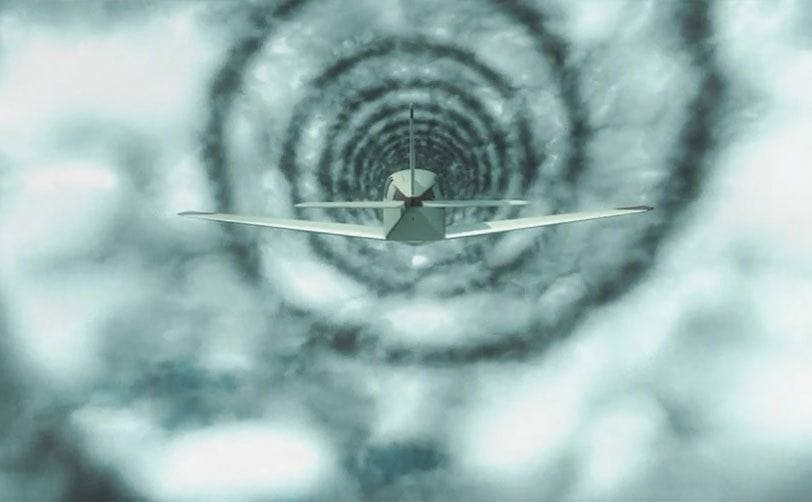 A small plane is flying through a cloud tunnel in the sky.