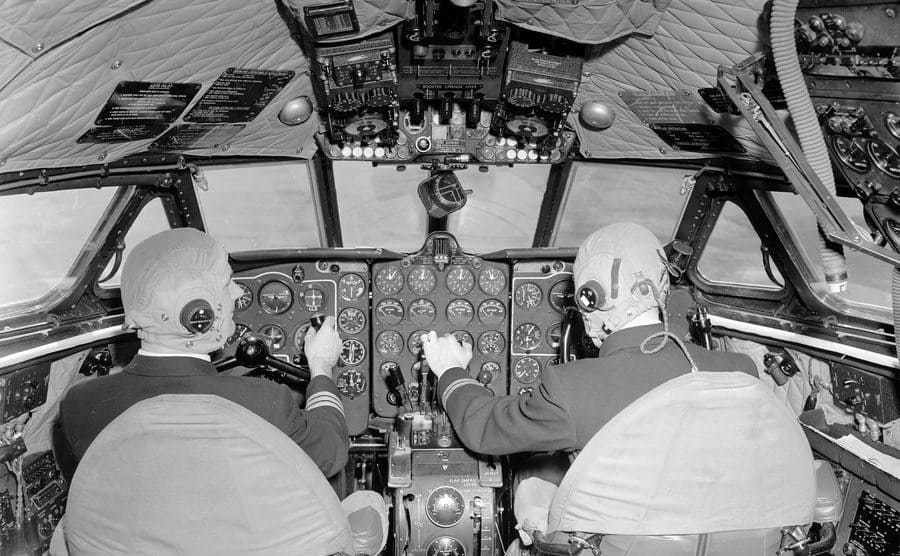 A pilot and his co-pilot flying a plane.