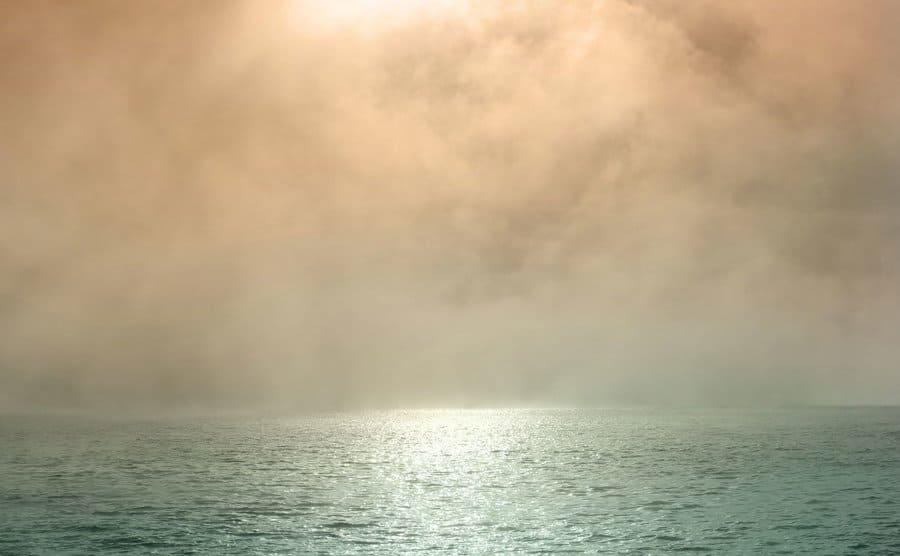 Morning mist over the ocean.
