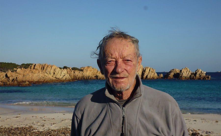 Mauro Morandi standing on the beach of Budelli.
