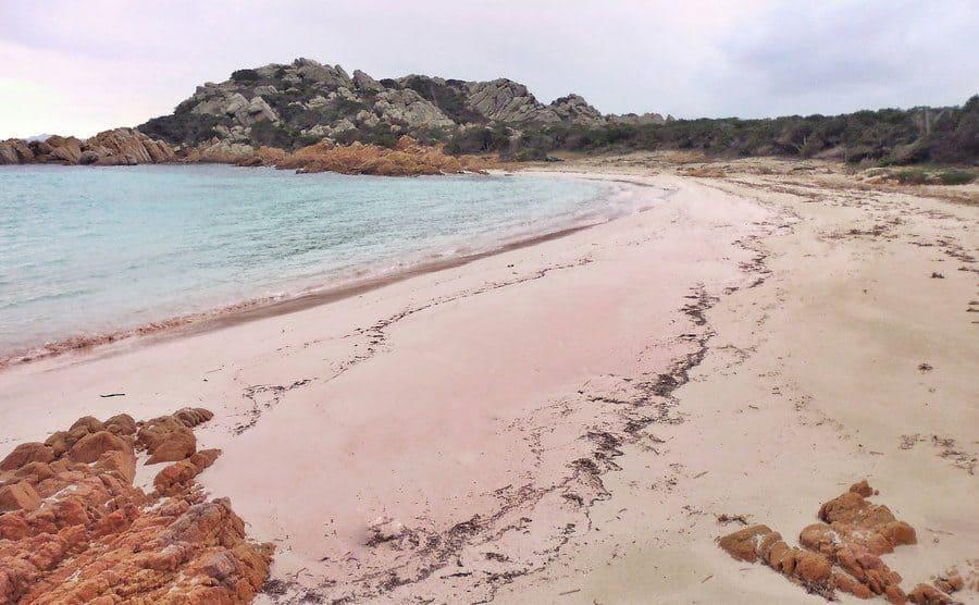 The pink sandy beach on the island.
