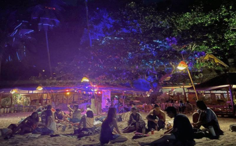 Guests and crew share their evening by the beach.