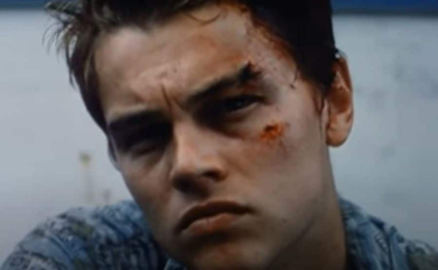 A close-up on Leonardo DiCaprio as he sails away from the island.
