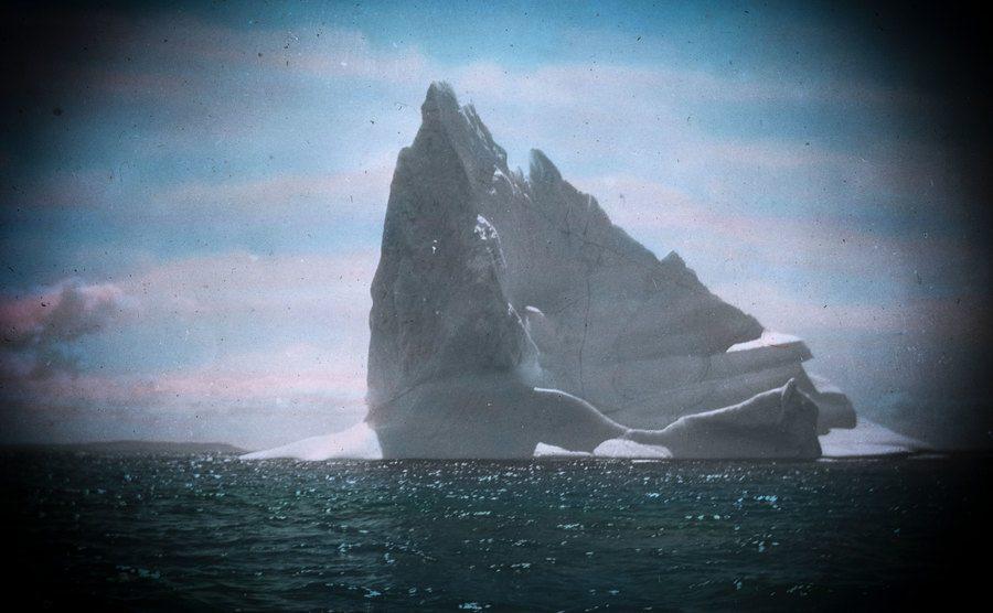 An iceberg ahead of the ship.