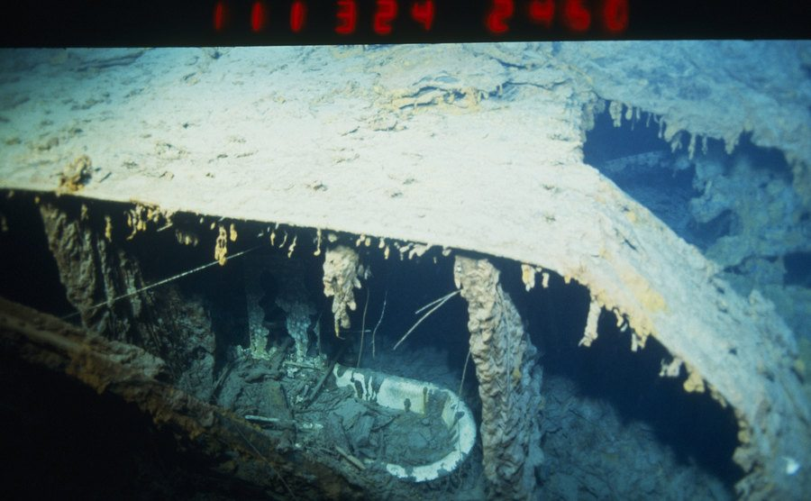 The deteriorated ship lies underwater.