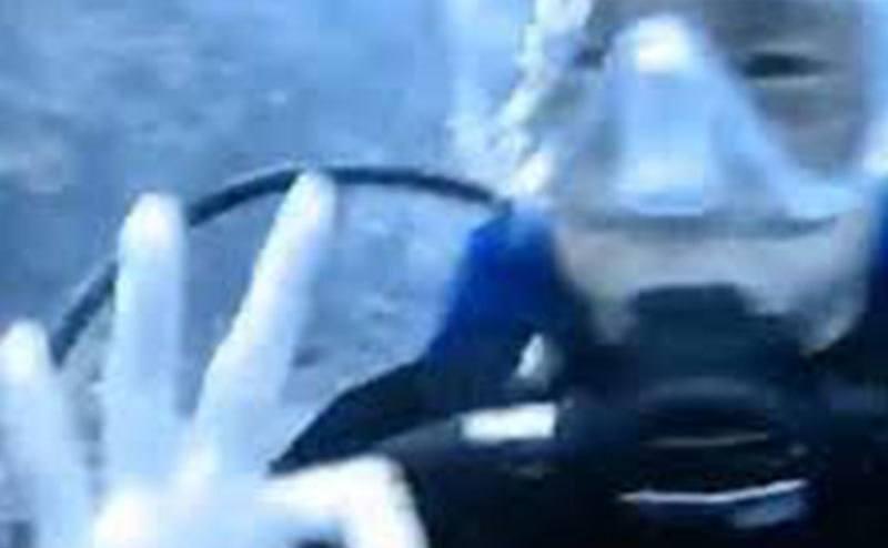 A scuba diver under water.