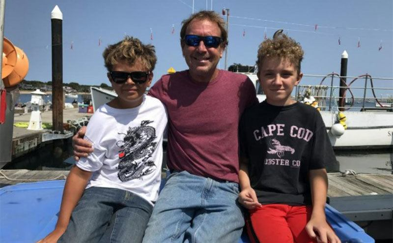 A picture of Michael and his sons on the bay.