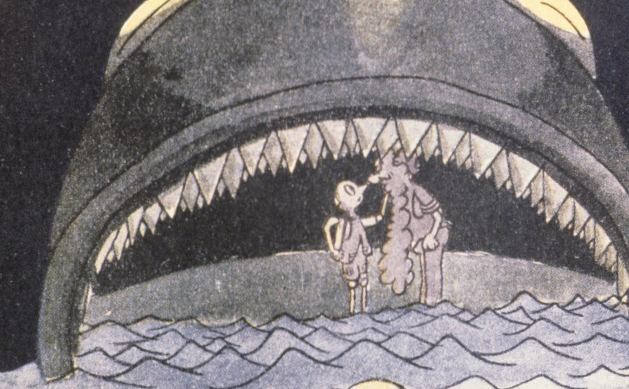 An illustration of Pinocchio and Geppetto in the whale's mouth.