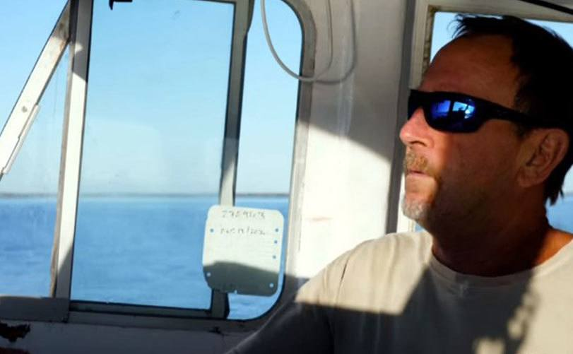 A still of Michael sailing during the televised interview.
