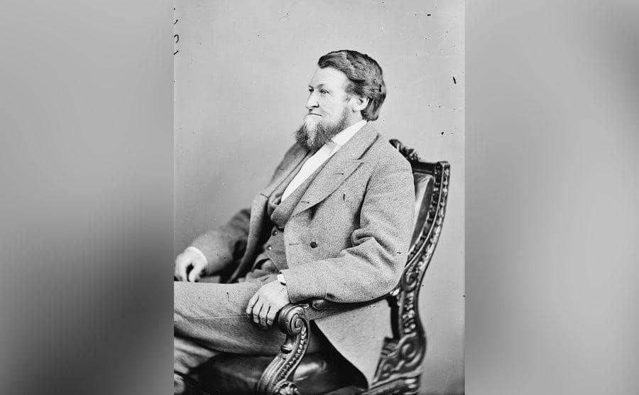 William Crutchfield sitting in an armchair.