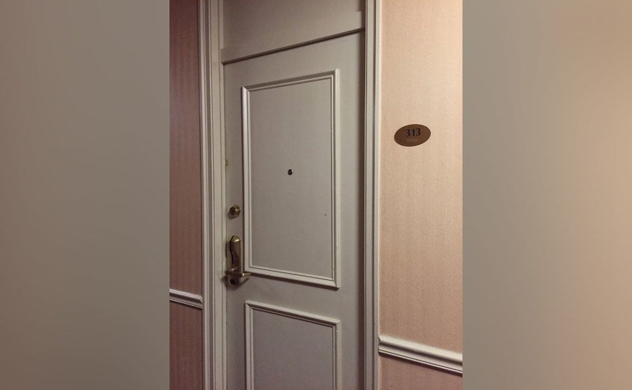 The door of room 313, formerly known as room 311.