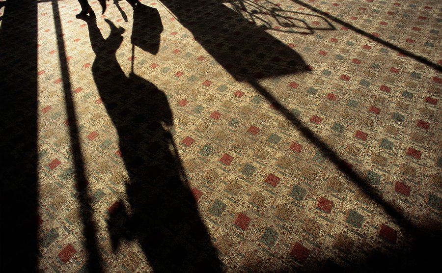 A shadow in a carpeted room.