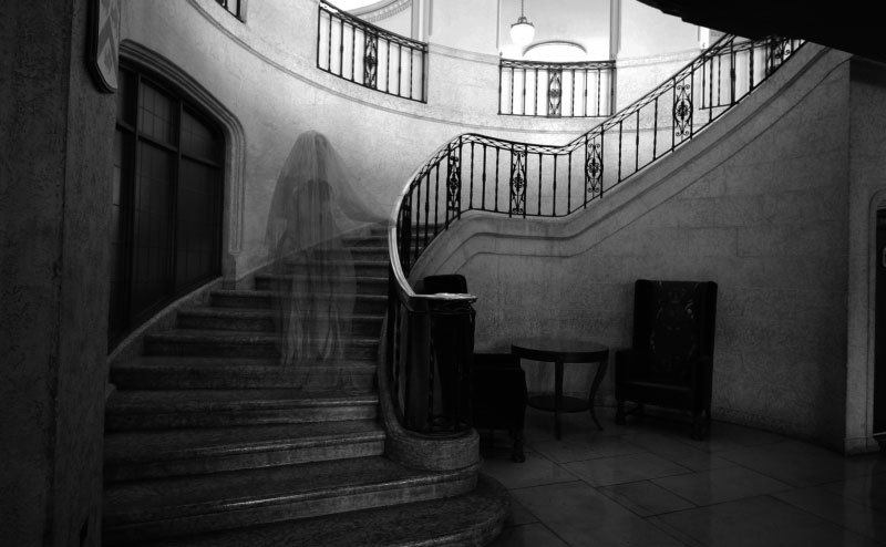 The Fairmont Banff Springs staircase with a ghost hovering her way up.