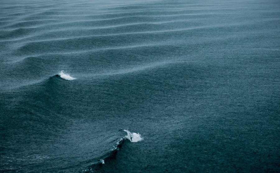 The rippling waves in the sea during a rainstorm.