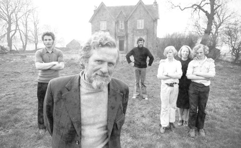 The Robertsons stand outside their house.