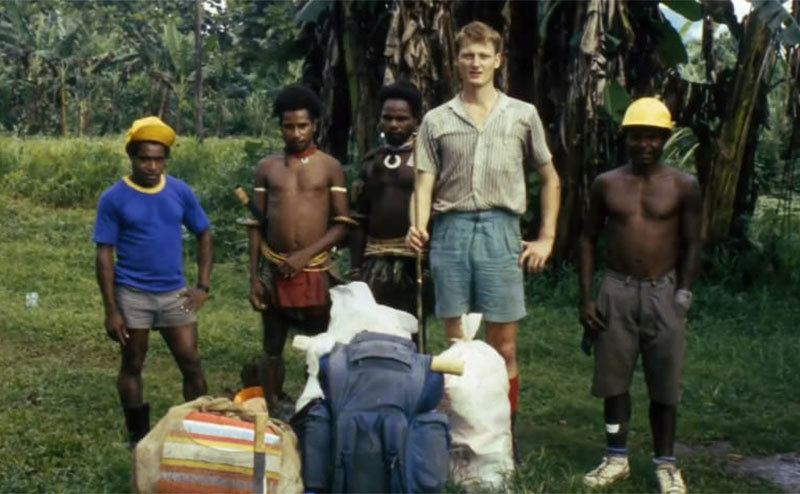Benedict Allen poses beside locals on a trip to Africa.