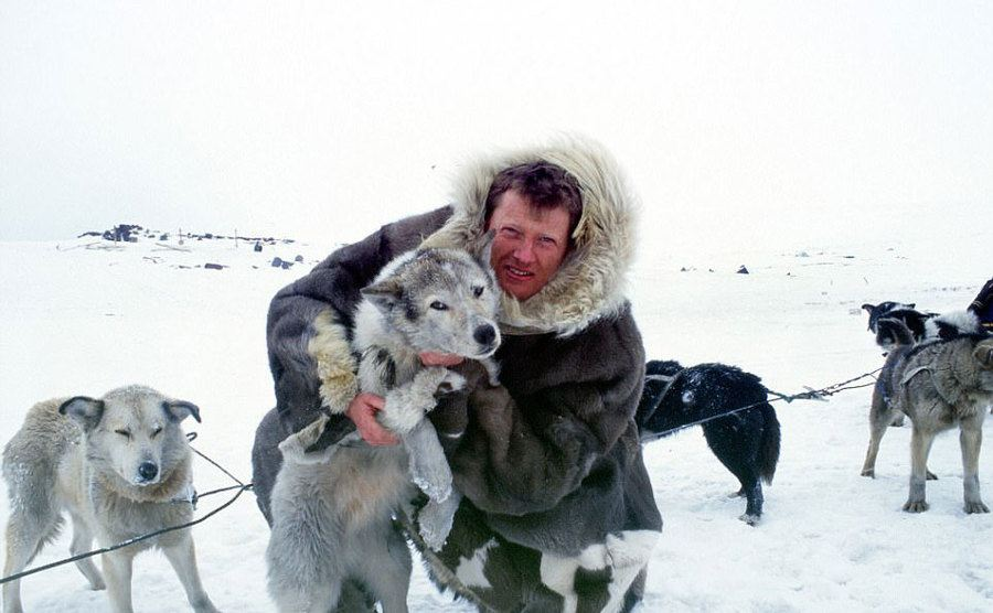 Benedict Allen poses with his dog while on a sled trip in Siberia.